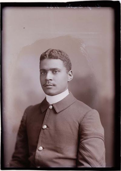 A photograph of Benjamin O. Davis Sr. at the age of 21 in 1901 wearing formal attire.