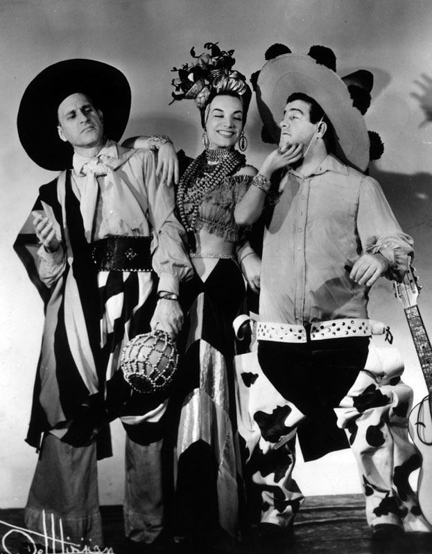 """Carmen Miranda in 1939 alongside American comedy duo, Abbott and Costello, in a photo taken to promote the show """"The Streets of Paris"""" which starred starred them all."""