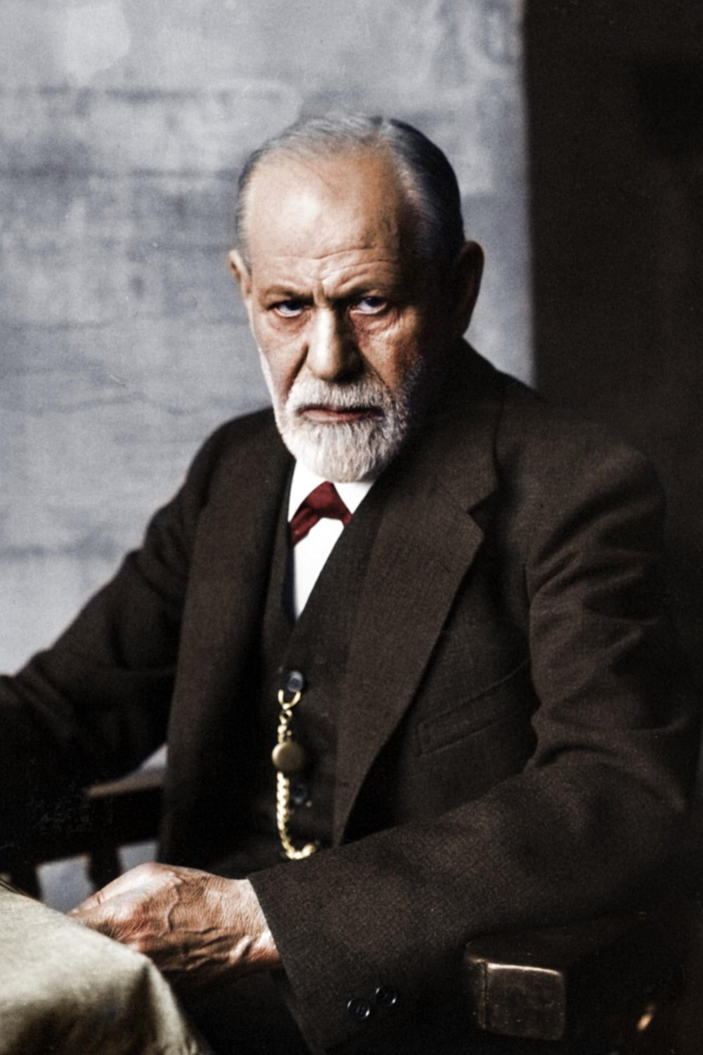 A colorized photograph of an elderly Sigmund Freud in c. 1930s. Colorization by Unknown.