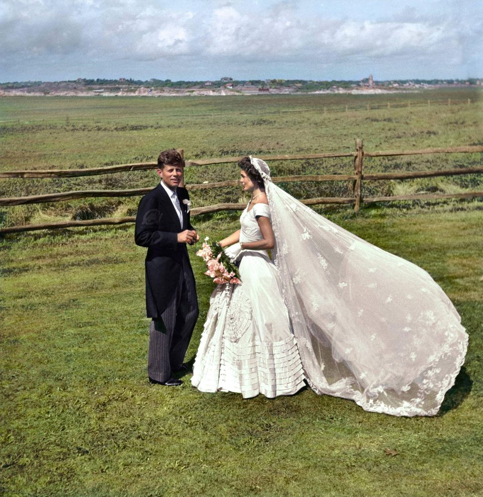 John F. Kennedy and Jacqueline Bouvier on their wedding day in Newport, Rhode Island on the 12th September 1953. Colorization by  Marina Amaral