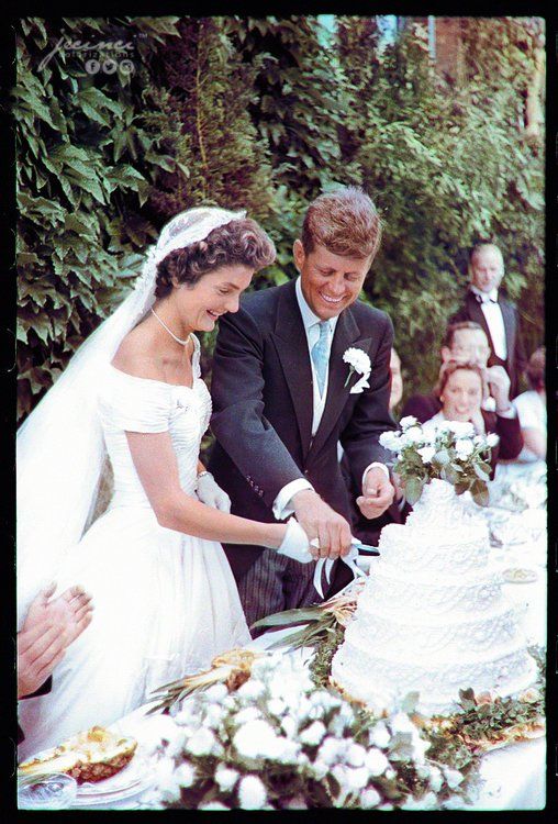 John F. Kennedy and Jacqueline Bouvier cutting cake at their wedding in Newport, Rhode Island on the 12th September 1953. Colorization by  Jecinci