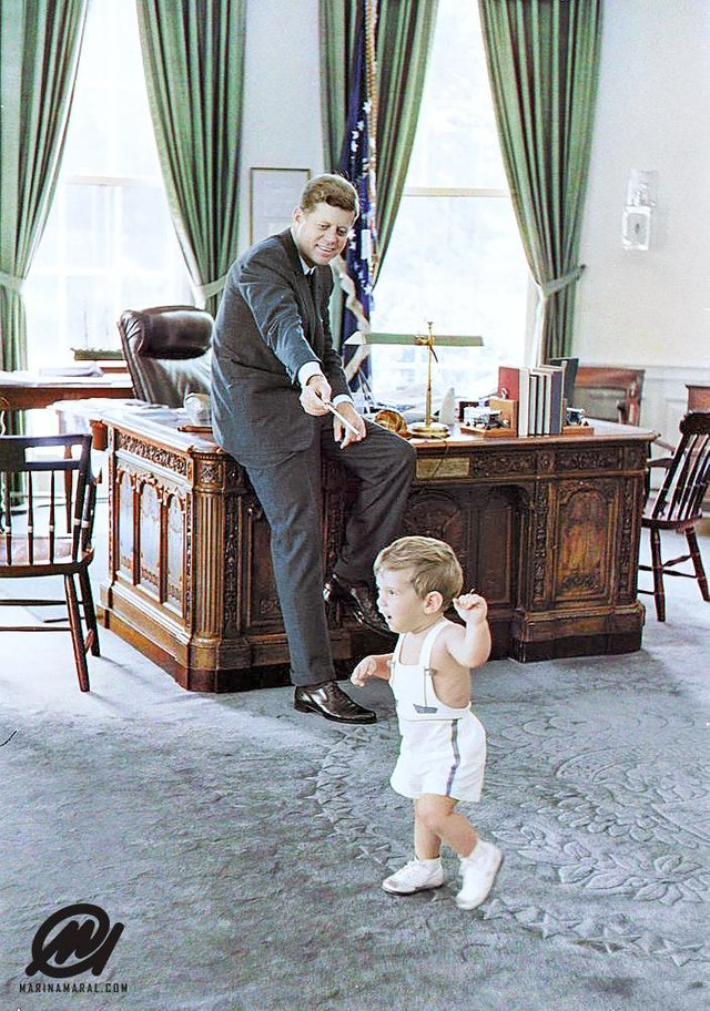 John F. Kennedy with his son, John F. Kennedy Jr., in the Oval Office in Washington, DC on the 25th May 1962. Colorization by  Marina Amaral