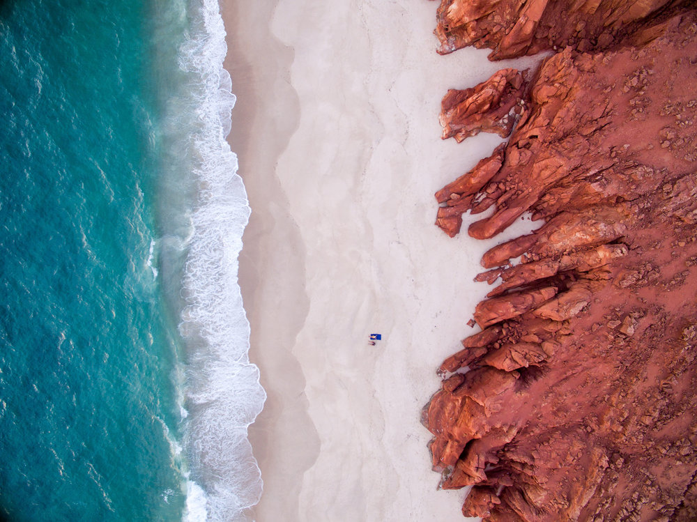 """Cape Leveque, WA, where white-sand beaches are bound by red cliffs and blue water."" Image by Places We Swim"