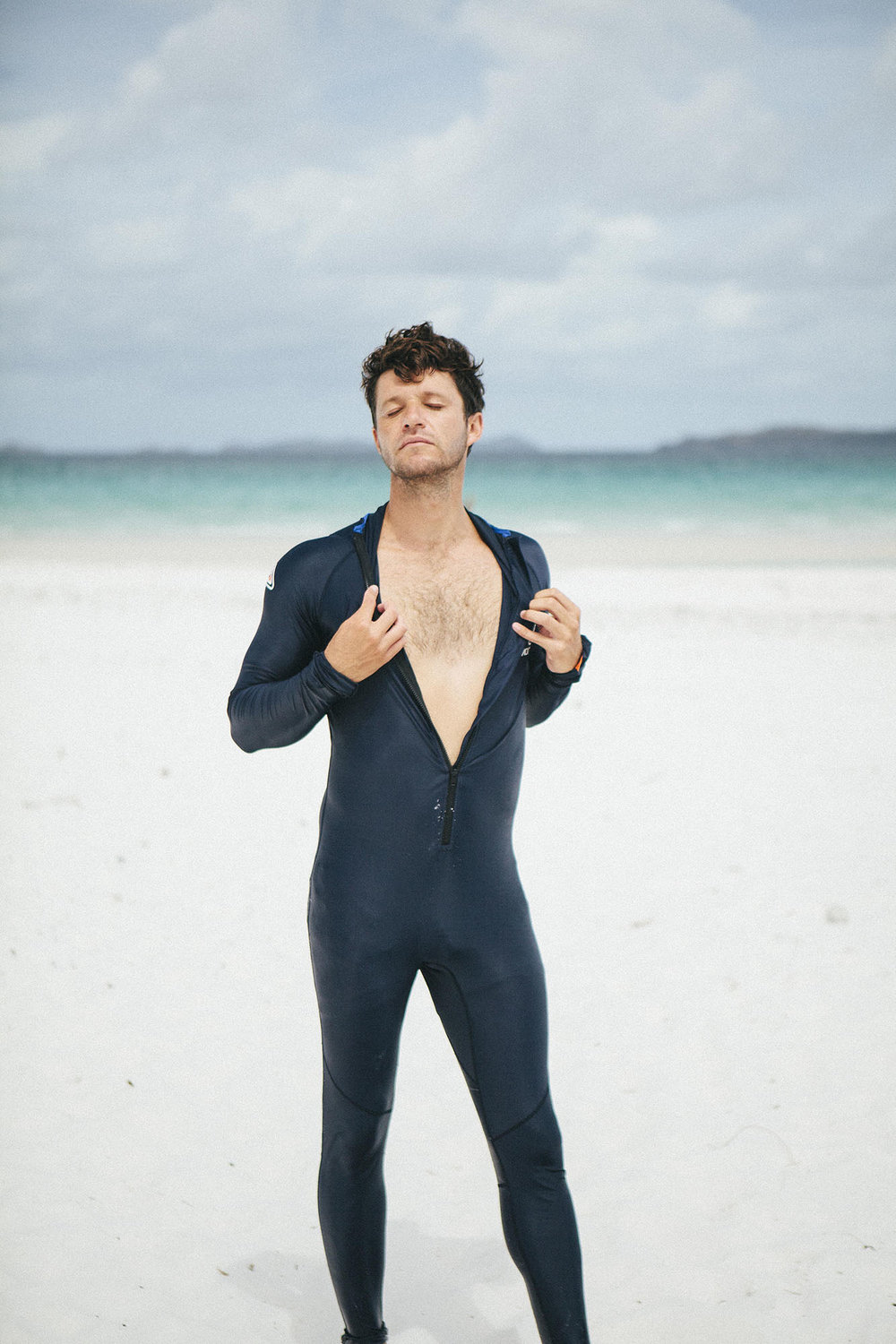 Dillon modelling the full body suit for stinger protection in the Whitsundays. Image by Places We Swim.