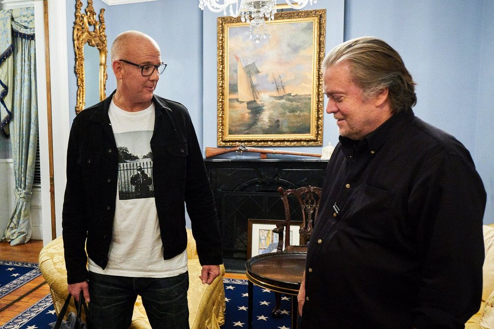 """John Heilemann  in a Supreme t-shirt with Chuck D (in a NY Jets hat, outside the fence on the South Lawn of the White House, circa """"Fear of a Black Planet"""") in his interview with Steve Bannon for The Circus , Photograph courtesy of    T.J. Kirkpatrick"""