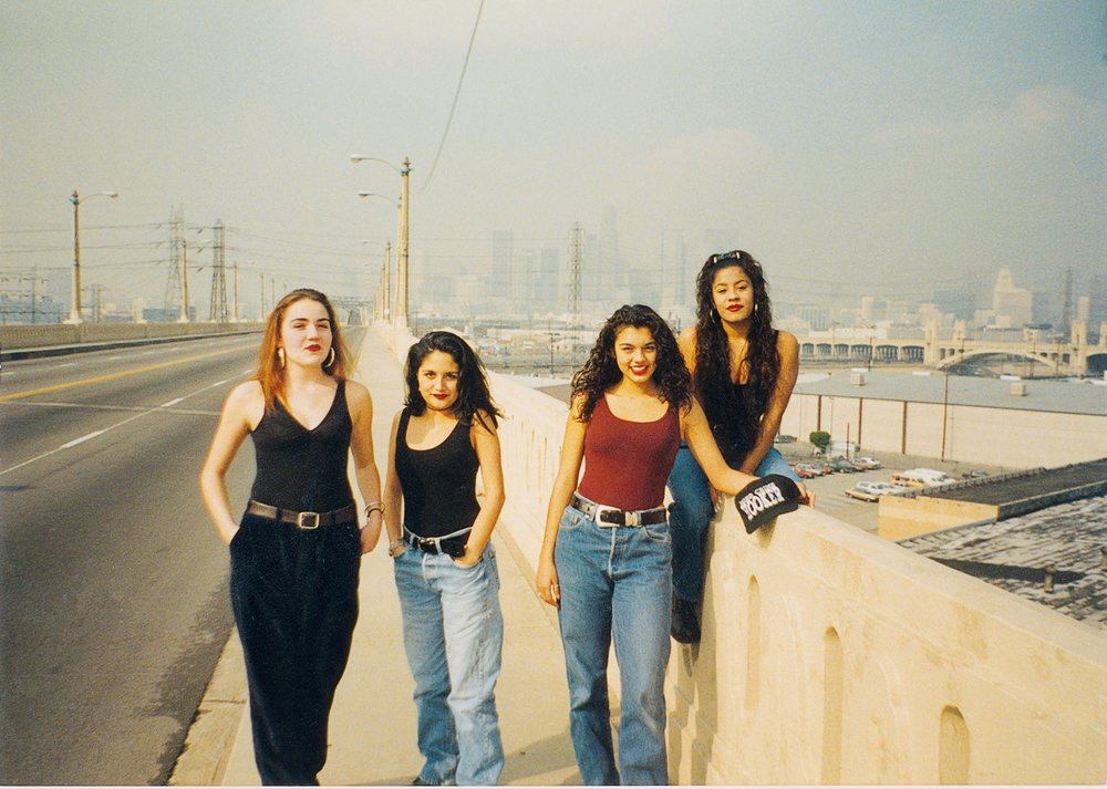 A party crew on 6th Street Bridge, in Boyle Heights, 1993    Courtesy of Guadalupe Rosales