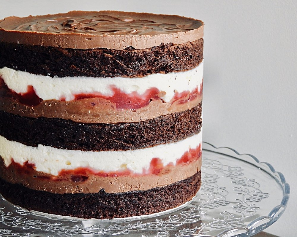 "Black Forest layer cake - Three layers of fluffy chocolate genoise sponge with white creme mousse, Belgian chocolate ganache and sour Morello cherry compote with just a hint of Kirsch.Gluten free and lactose free also available.5""-6""/13-15cm tall10-12 serves$75"