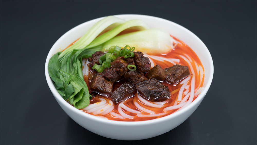 DU BRAISED BEEF RICE NOODLES 杜家私房牛肉米粉 - Family Recipe for over 40 years! Served with steamed vegetables & scallions