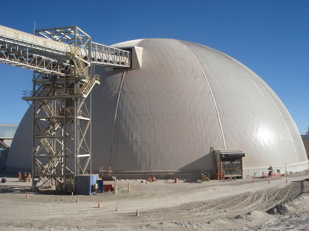 Dust is contained with a covered stockpile.