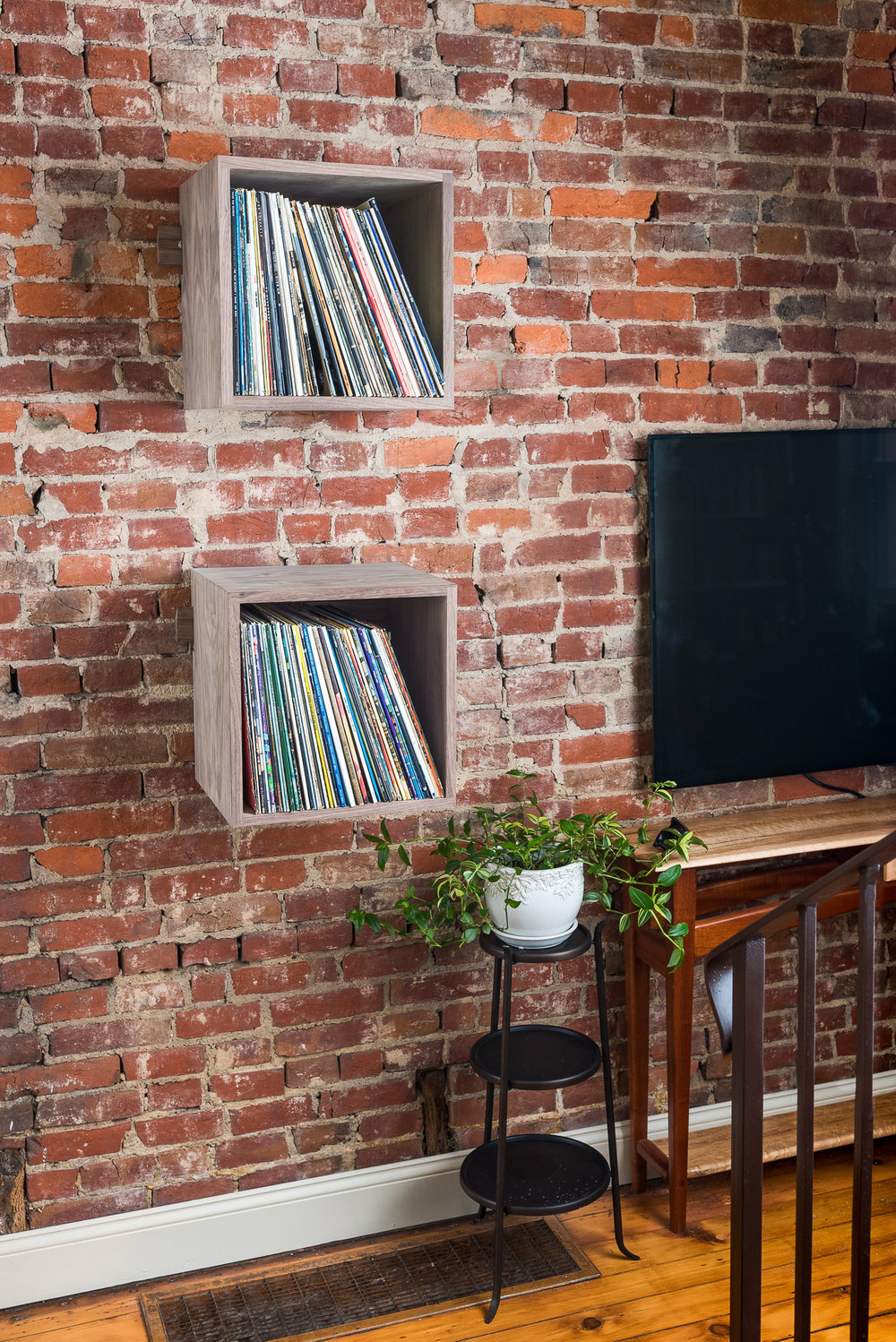 Deep Cut Walnut Record Shelves - Exposed Brick - Front Left Portrait.jpg