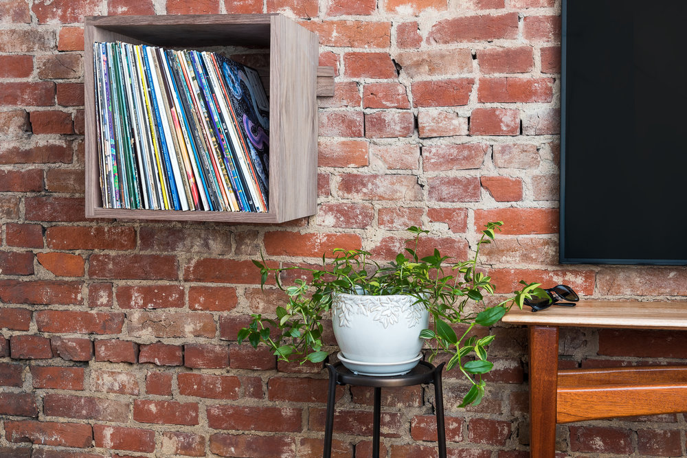 Deep Cut Walnut Record Shelves - Exposed Brick -Front Right Landscape Close.jpg
