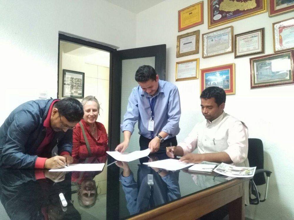 Tripartite signing.jpg