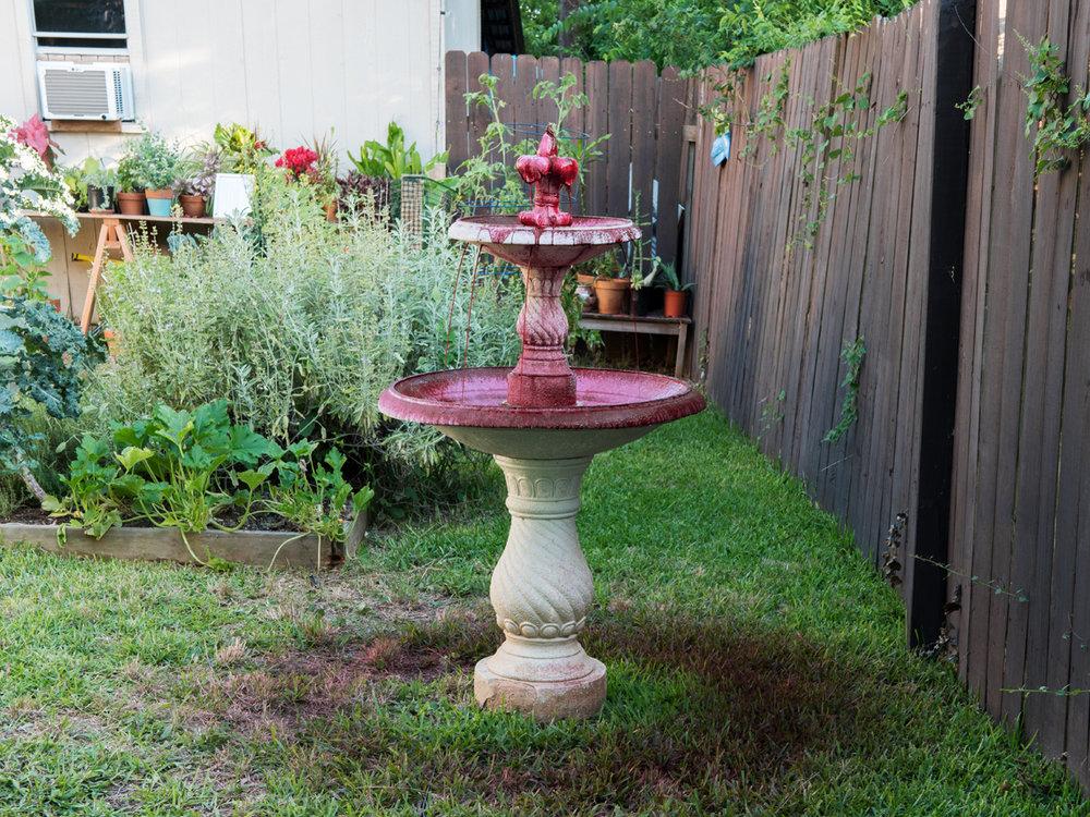 Ryan Hawk     Blood Bath   garden fountain, water, pigment, paper clay  4'x2.5', 2018