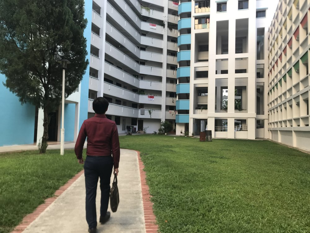 Jim outside HDB estate.JPG