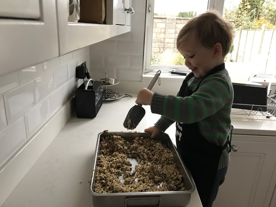 Don't let that sweet little face fool you. He will tip that entire baking tray over his own head if you turn your back for a split second.