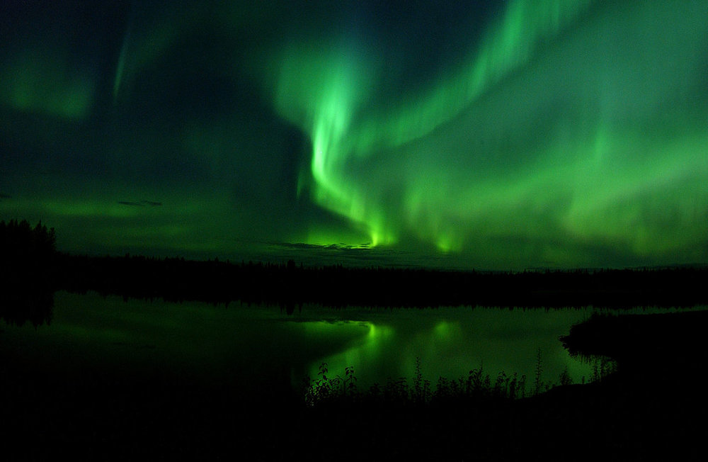 1280px-The_Aurora_Borealis_or_Northern_Lights_shine_above_Bear_Lake_in_Alaska_050910-F-MS415-009.jpg