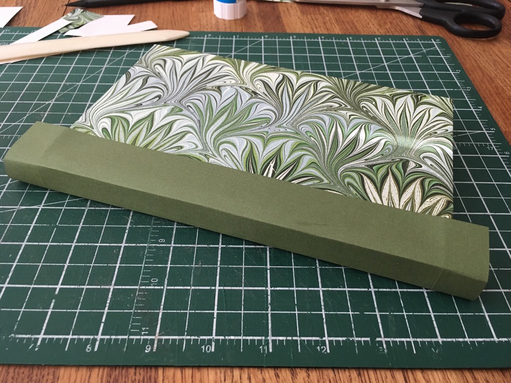 Step 8: - I've glued the spine card over the cover on either side. I'd rather have a darker green card for this, but I couldn't get any with the right texture and weight.