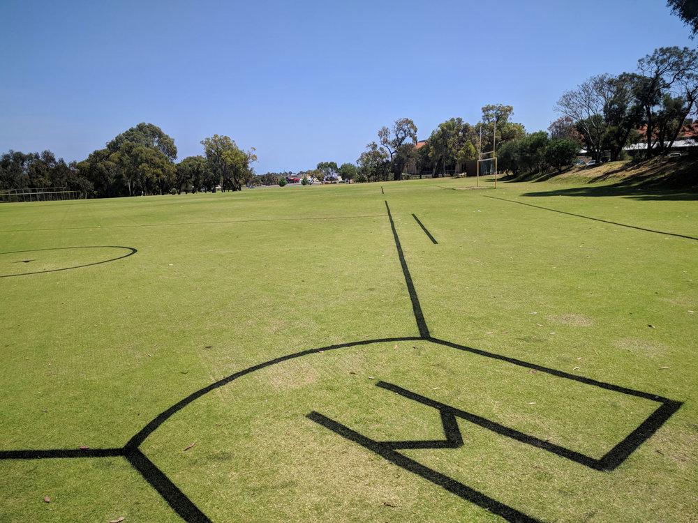softball field in black line marking paint