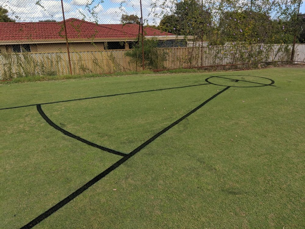 Shotput with sector in black line marking paint