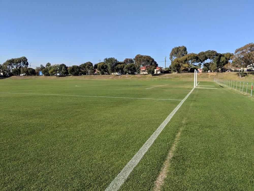 Soccer field baseline in white line marking paint