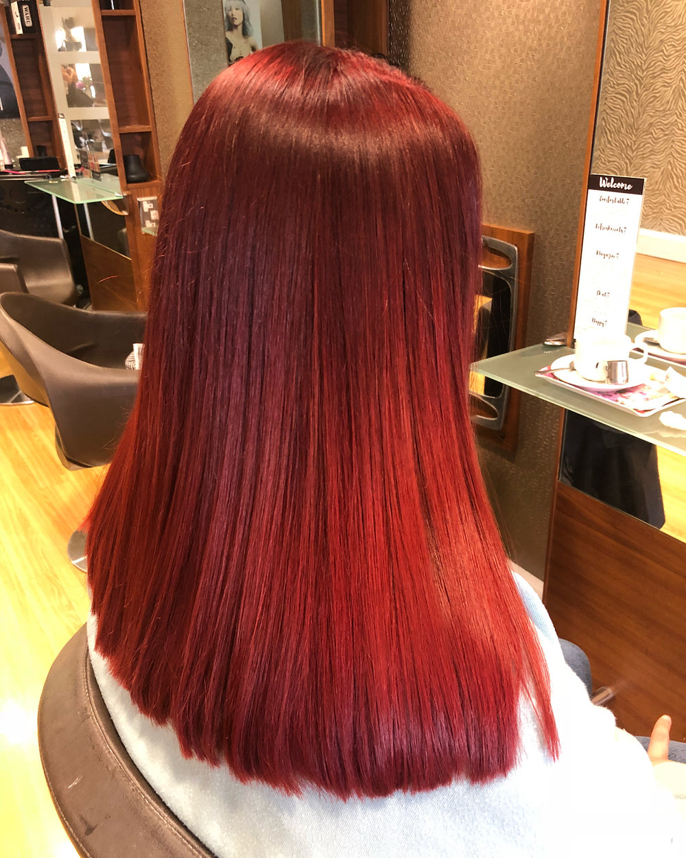 Salon coloured vibrant red hair at Joanne Hairdressing