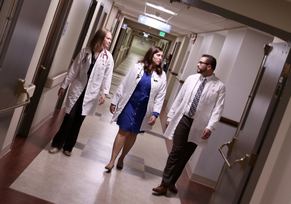 Three doctors in a hallway