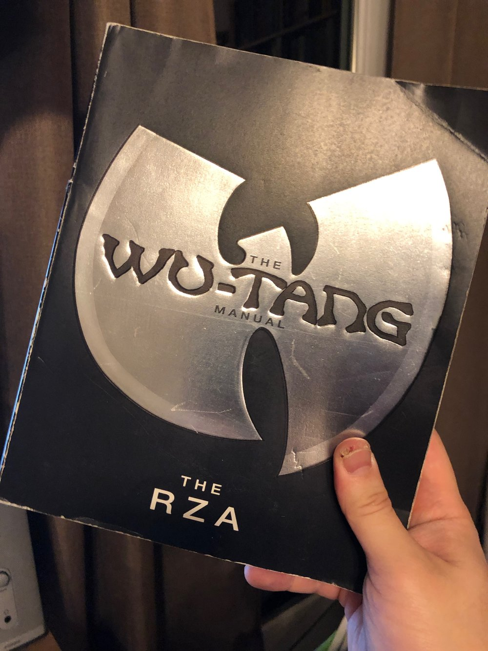 Mendez holding his (probably stolen) copy of  The Wu-Tang Manual  by the RZA.