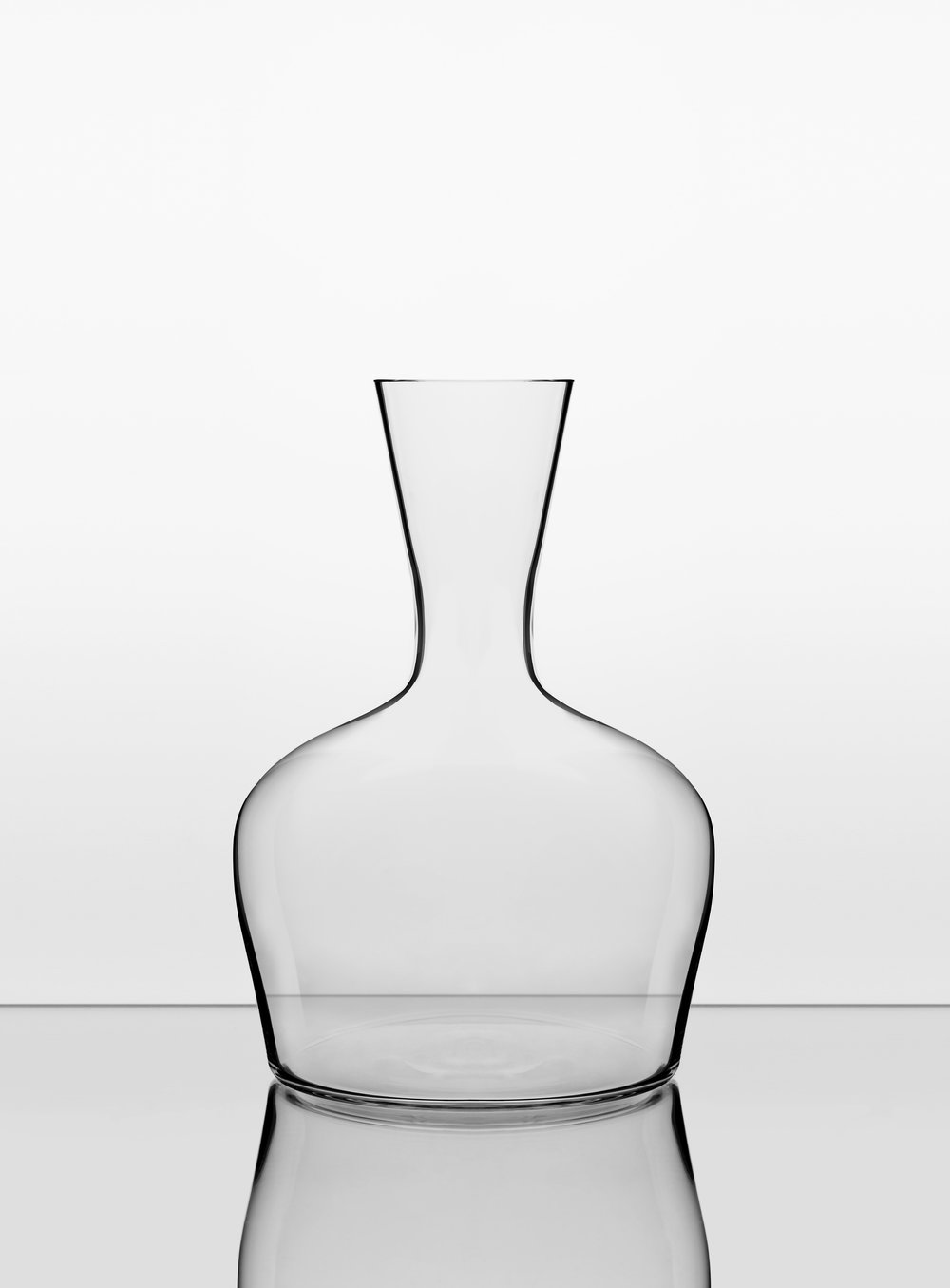 The Young Wine Decanter. - This is a generous and bold decanter for young wines needing aeration and maximum surface area for the wine.The long neck allows for a strong grip which will allow you to swirl the wine energetically, allowing oxygen to encourage and hasten a young wine's evolution and mellow the flavours.The bowl is also large enough to accommodate a magnum.