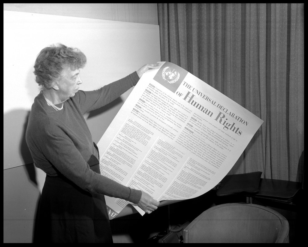 Eleanor Roosevelt of the United States holding a Declaration of Human Rights poster in English. (United Nations, Lake Success,New York).