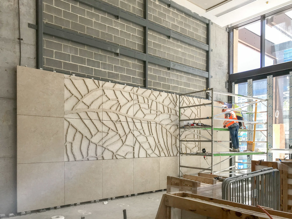 'Ningaloo III'  Relief sculpture in sandstone being installed in the bar area