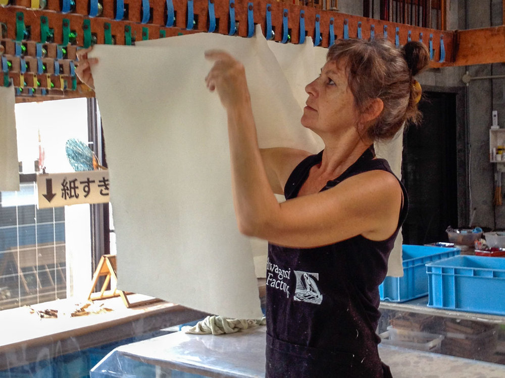 Claire hanging handmade washi paper to dry at the Awagami factory