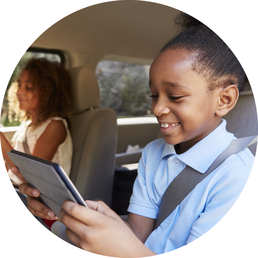 children-using-digital-devices-on-car-journey-PLZTHYQ copy.png