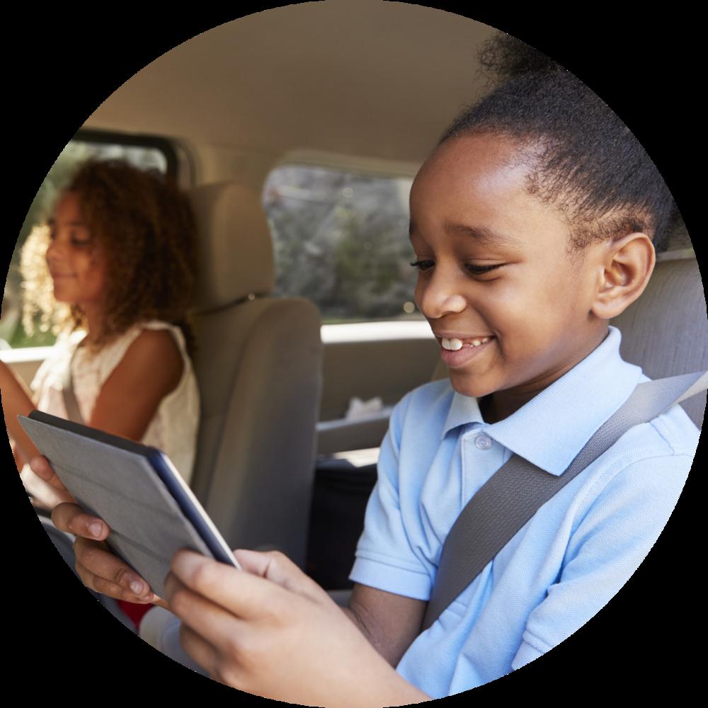 children-using-digital-devices-on-car-journey-PLZTHYQ copy.png