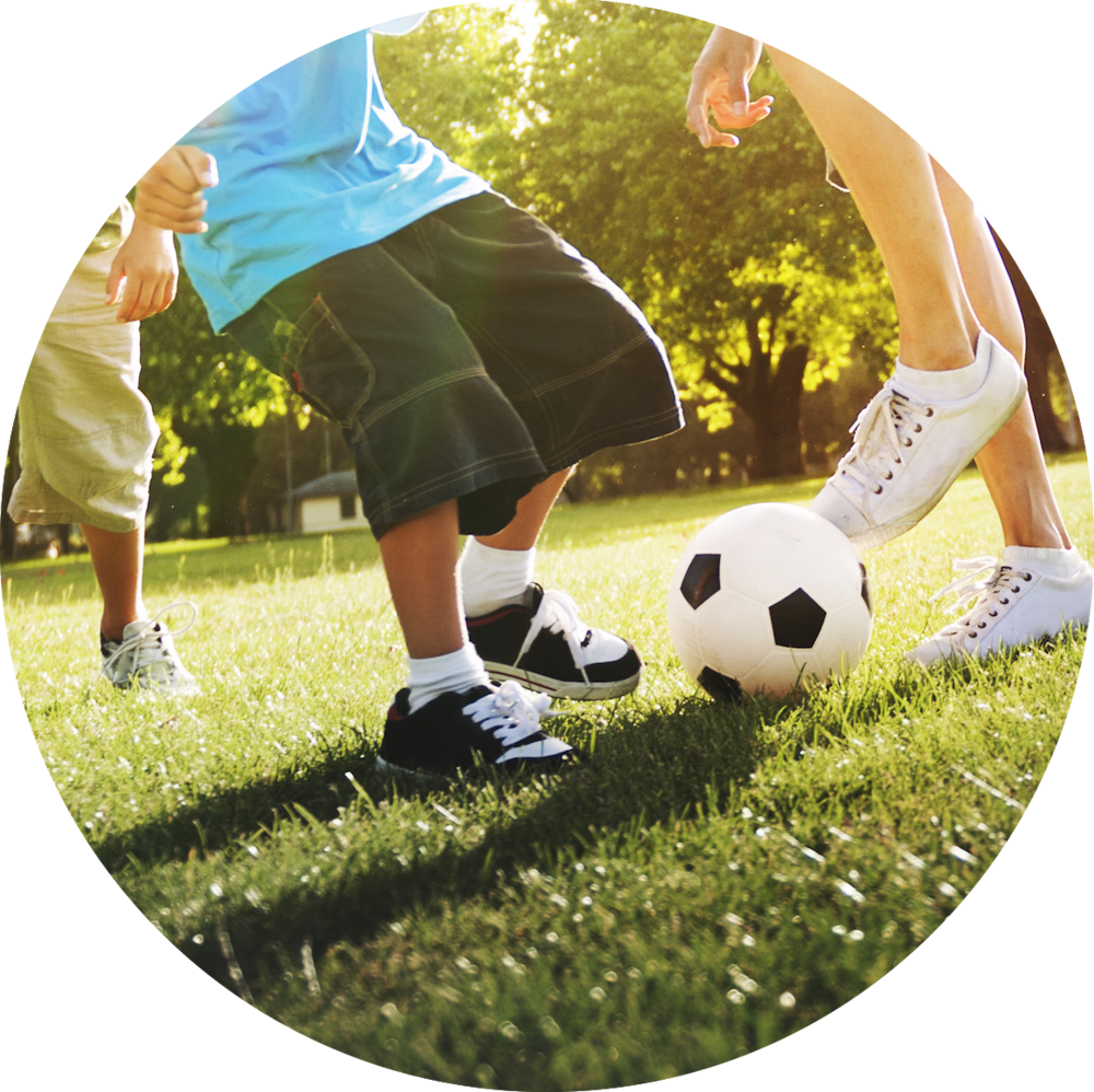 little-boy-playing-soccer-with-his-father-concept-PSZSEDU.png