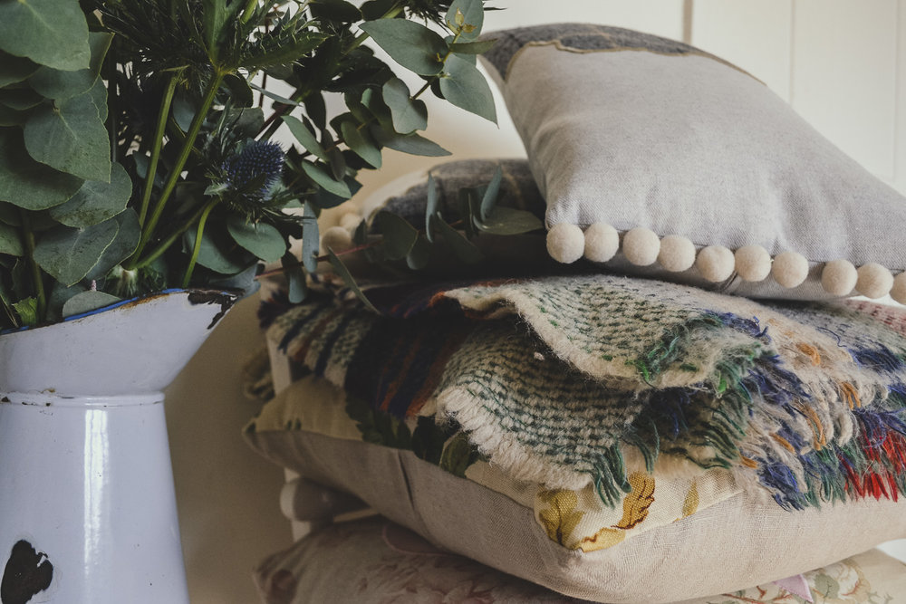 Pile of cushions and blankets - Get Cosy this Autumn and Enjoy the Best of the Season