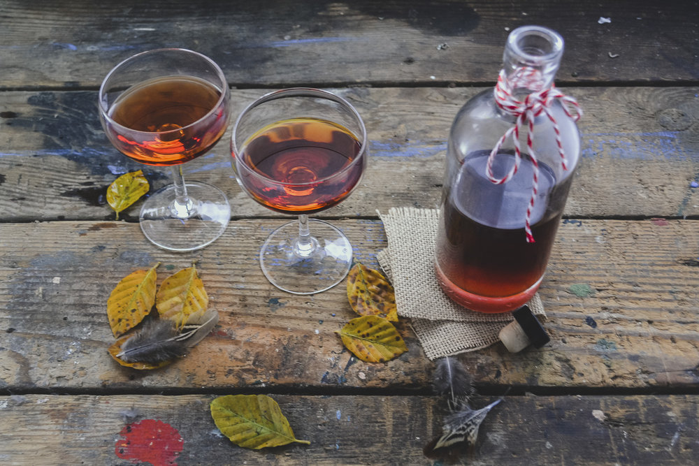 Sloe Gin poured into glasses - how to make sloe gin recipe