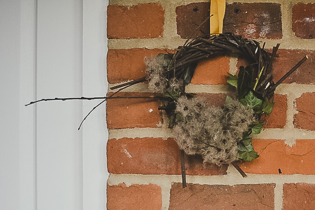 Rustic christmas wreath - handmade using willow rods and hung up with a yellow ribbon