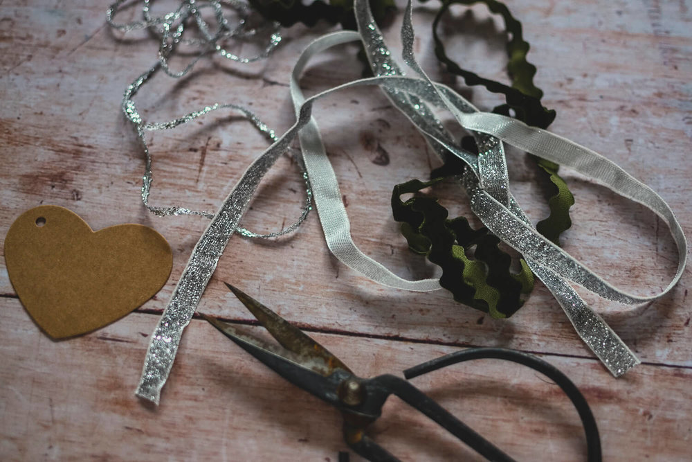 Ribbons and scissors on a rustic wooden table