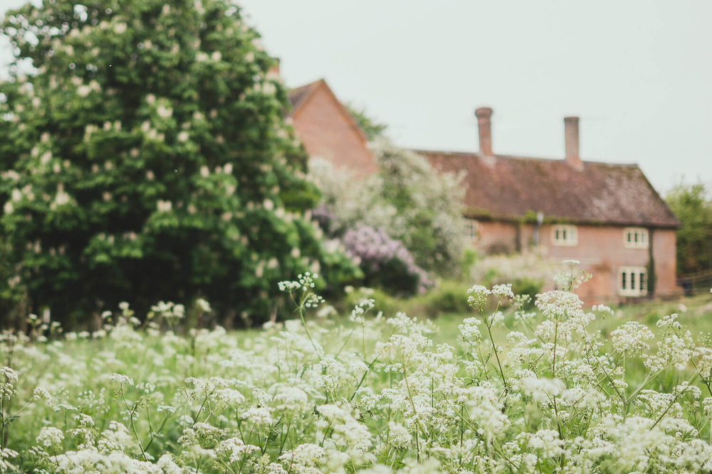 Coutryside farmhouse on a spring day with cow parsley - Journaling prompts for makers and designers