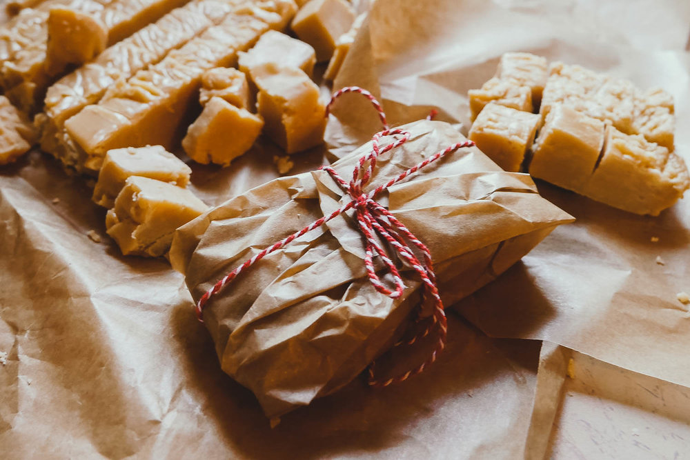 Parcel of fudge wrapped in brown paper and bakers twine