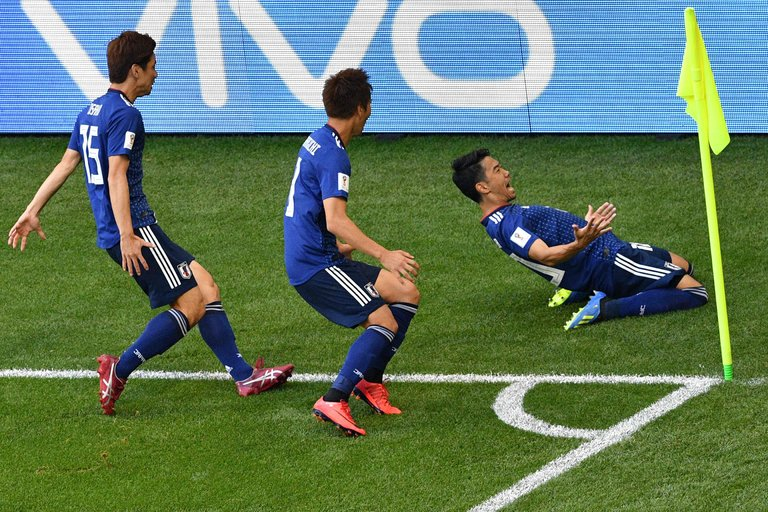 Japan player is excited to clean the locker room...or a he scored (Courtesy Mladen Antonov/Agence France-Presse)