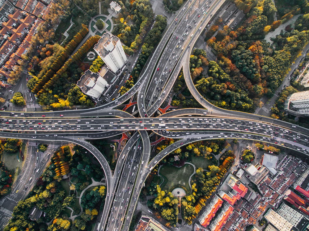 aerial-view-drone-city-traffic-denys-nevozhai-unsplash.png