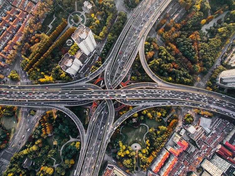 Aerial View Drone City Traffic Denys Nevozhai Unsplash