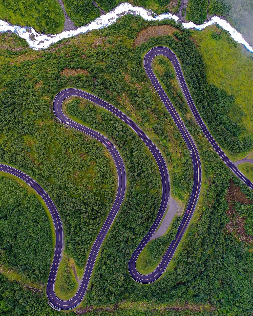 aerial-view-drone-river-trees-duprat-unsplash.png