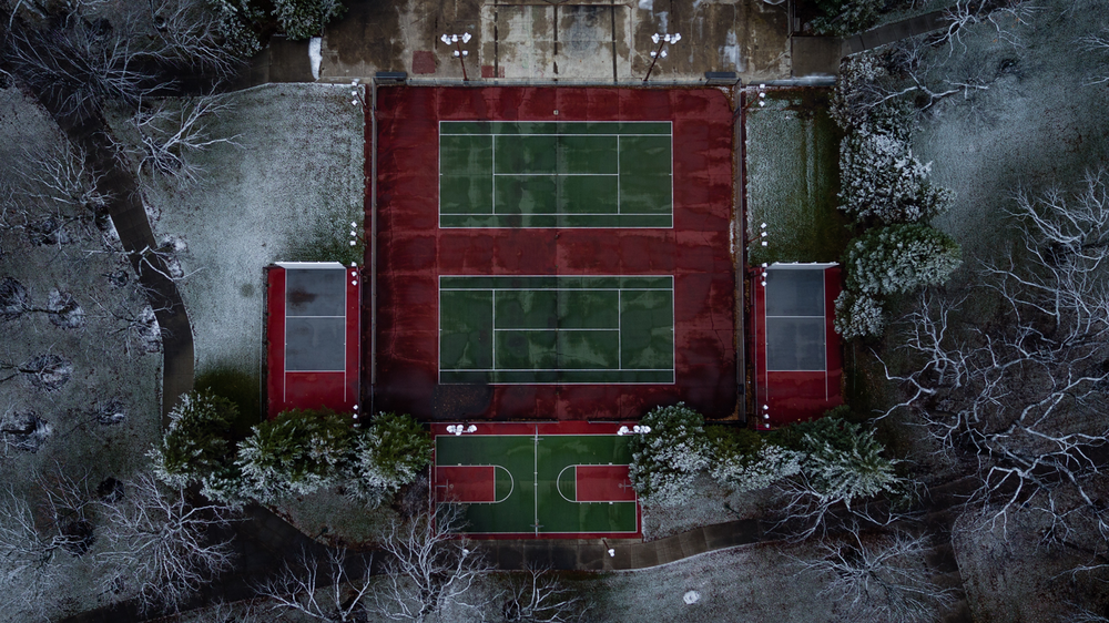 aerial-view-tennis-court-frost-will-dehoogh-unsplash.png