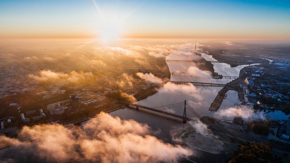 aerial-view-city-bridge-sunset-drone-alex-unsplash.png