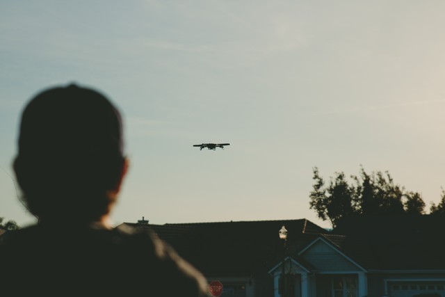 Drones must be flown within visual line of sight of the pilot and/or a spotter. (Photo by Caleb Woods on Unsplash.)