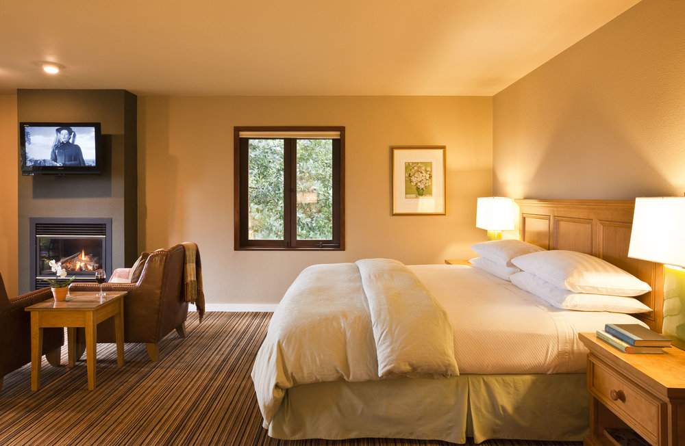 The Madrone room with comfy king size featherbed, flat screen TV, and leather seating around a fireplace