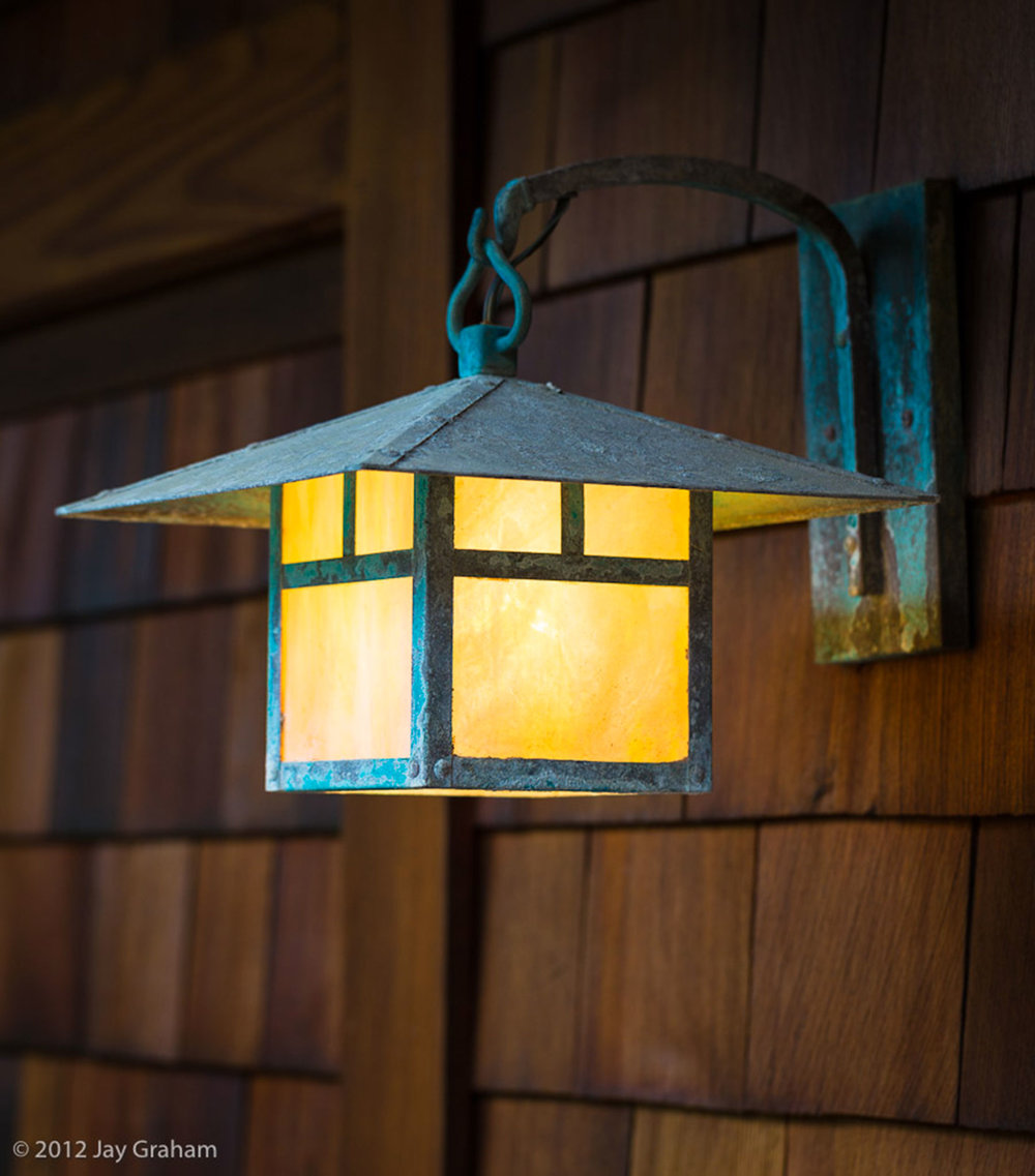 A copper and glass exterior light.