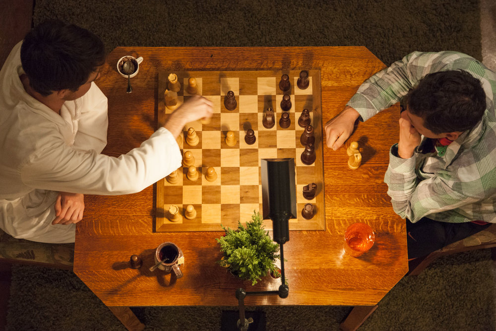 a bird's eye view two men playing chess at Brewery Gulch Inn
